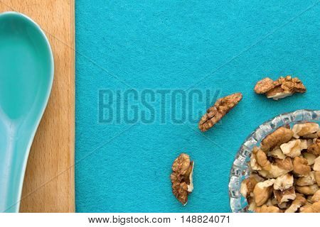 Walnuts. Top view of wooden Board and blue background. For kitchen and menu