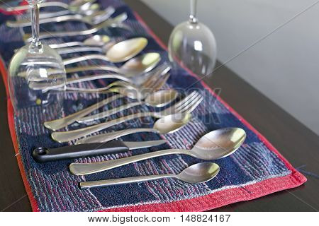 Various washed dishes laid on a kitchen towel, focus in the foreground, studio shot with a shallow depth of field