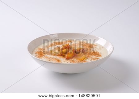 plate of semolina pudding with apples and cinnamon