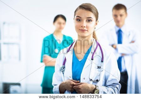 Woman doctor standing with stethoscope at hospital .
