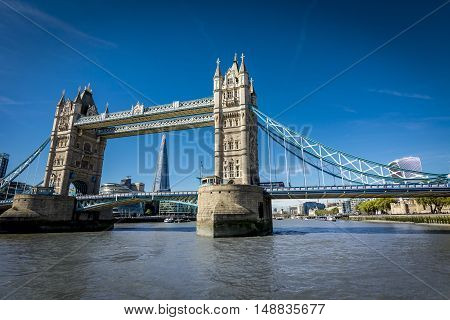 View of Tower Bridge, The Shard and other London landmarks from the Thames