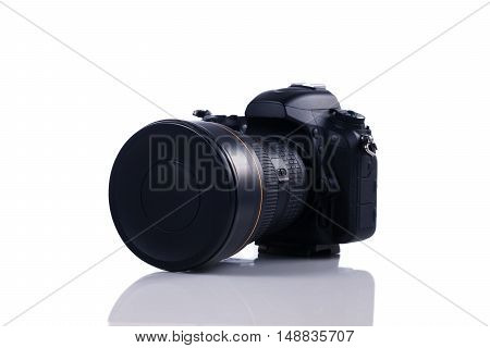 Modern DSLR camera with wide angle lens isolated on white background
