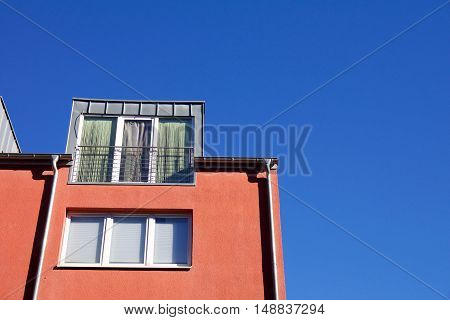 Red House With Dormer Window
