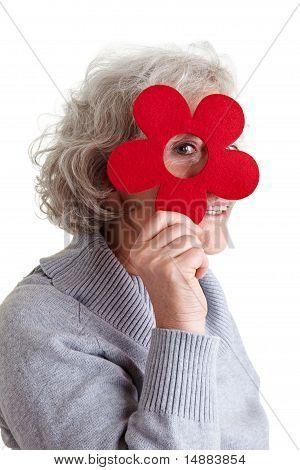 Senior Woman Looking Through Felt Flower