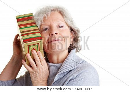 Senior Woman Shaking A Gift