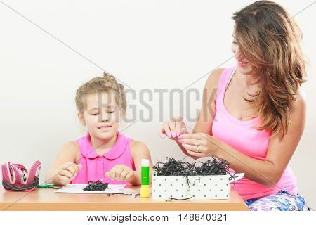 Little girl work with mom. Parenting cooperation common fun
