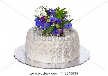 Wedding white cake. Decorated with spring flowers.