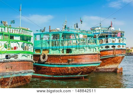 Dubai, United Arab Emirates - May 3, 2013: close up of traditional wooden boat docked on Bay Creek. The creek is divides the city into two main sections Deira and Bur Dubai old downtown of Dubai.