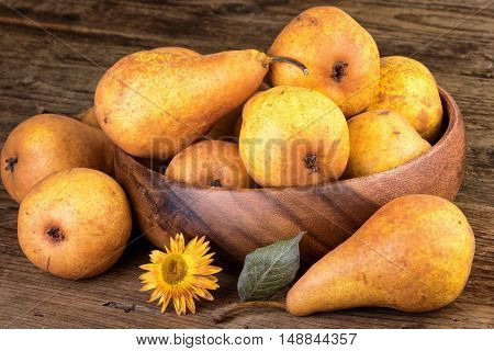 Ripe pears in farmhouse style on wooden table