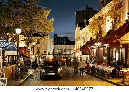 PARIS, FRANCE - MAY 13: City street view on May 13, 2015. With the population of 2M, Paris is the capital and most-populous city of France.