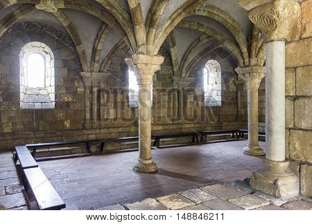NEW YORK, UNITED STATES - NOVEMBER 2, 1015: An old room at the Cloisters in New York City showcases an old Gothic architectural space with pillars and vaulted ceilings.
