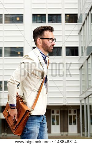 Middle Aged Man With Bag Walking Outdoors