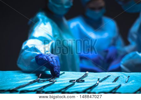 Team surgeon at work in operating.