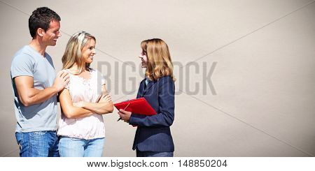 Real Estate agent woman with clients.