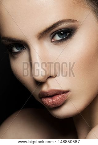 Beautiful woman model portrait with red lips closeup . Black background