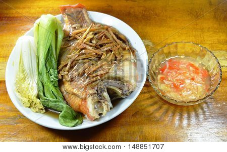 steamed red mango fish with vegetable topping slice ginger dipping spicy sauce