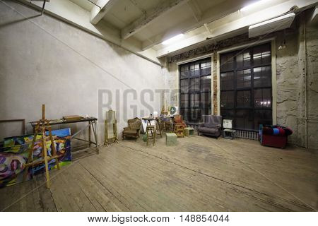 MOSCOW - DEC 09, 2014: The interior of the studio with furniture and various props