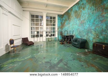 MOSCOW - DEC 09, 2014: The interior of the studio with white and dark green walls and furniture