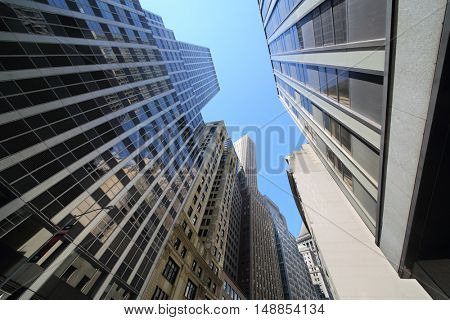 NEW YORK, USA - SEP 07, 2014: The facades of skyscrapers in the narrow streets of New York, view from the bottom up