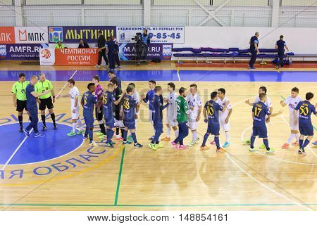 MYTISHCHI, RUSSIA - OCT 16, 2014: Team football players shake hands after the Russian Futsal Super League in Mytishchi