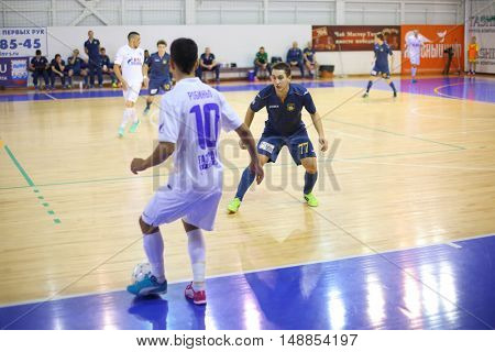 MYTISHCHI, RUSSIA - OCT 16, 2014: Sportsmen running for the ball on the Russian Futsal Super League in the Sports Complex Construction in Mytishchi