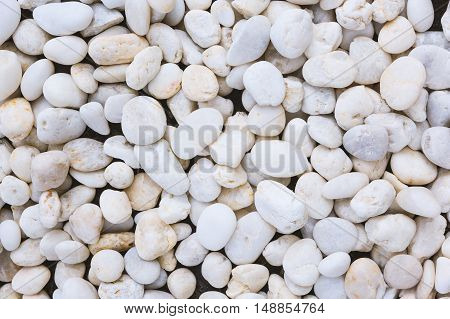 White pebble stones texture and background - White rock