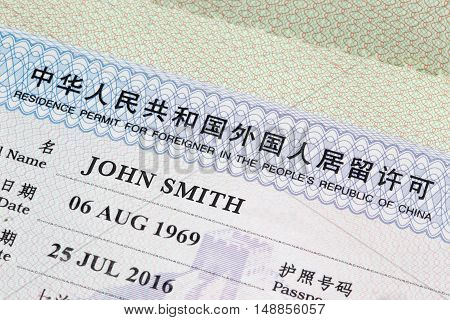 ShanghaiChina 25/09/2016 Chinese visa closeup in a passport with the most generic american name john smith