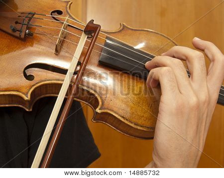 Close up on violin playing