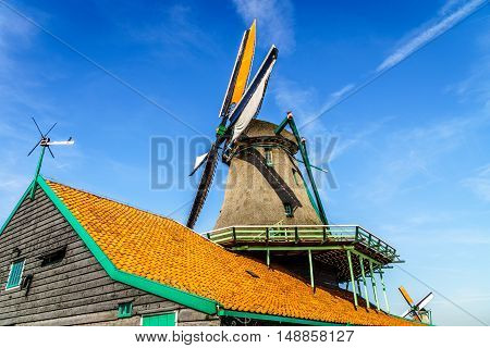 Fully operational historic Dutch Windmills along the Zaan River at the village of Zaanse Schans in the Netherlands