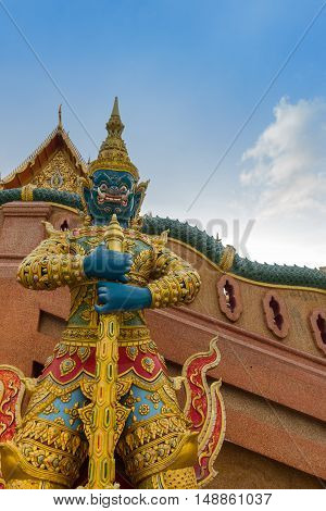 Giant statue in front of temple, Thai art.