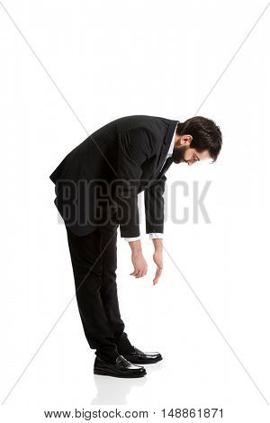 Young businessman bending down.