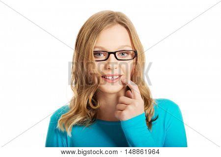 Thoughtful teenage woman