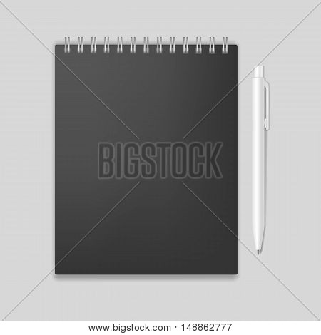 Blank realistic spiral notebook mockup with pen