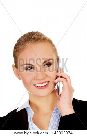 Smiling business woman talking through the phone.