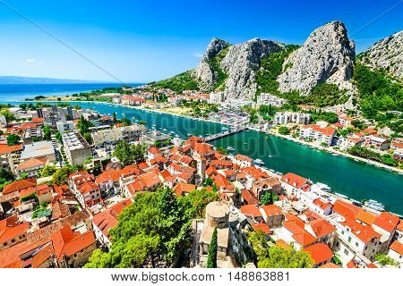Omis Croatia. Dalmatia Coast panorama with emerald-green Cetina River Croatian travel landmark at Adriatic Sea.