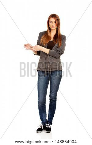 Teenage woman holding her wrist - pain concept