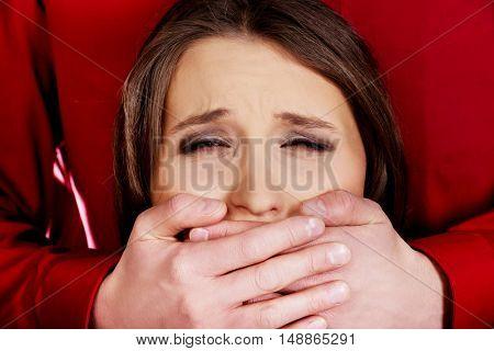 Man kidnapping young woman