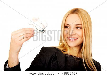 Pregnant businesswoman holding plane model