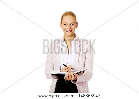 Young smile business woman making a notes