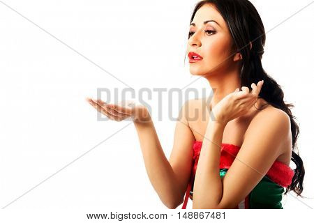 Woman wearing elf clothes blowing kiss