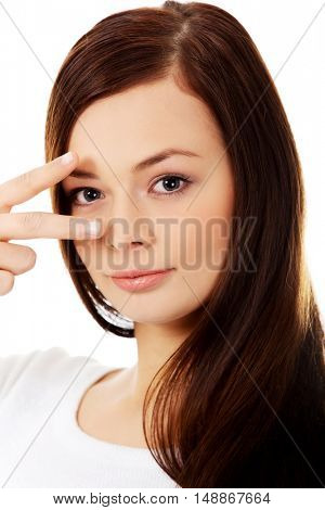 Young happy woman showing two fingers