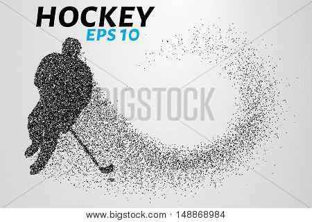 Hockey player of the particles. Silhouette of a hockey player consists of points.