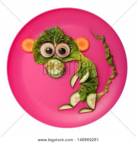 Amusing monkey made of vegetables on plate