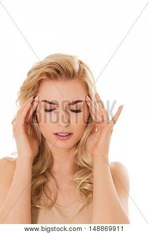 Young beautiful woman with huge headache