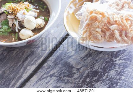 Noodles in Thailand ,Kuay-Teaw-Nam-Tok fastfood of thai on wooden table.Top view and zoom in.1