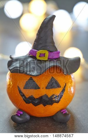 Funny Halloween pumpkin tangerine with black witches hat