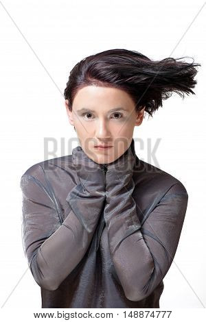 Fashion photo of attractive young brunette woman with styled and flying short hair
