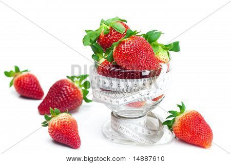 Big Juicy Red Ripe Strawberries In A Glass Bowl And Measure Tape Isolated On White