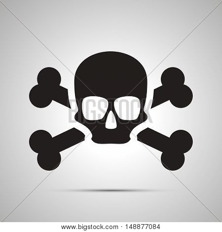 Human skull with bones simple black icon with shadow