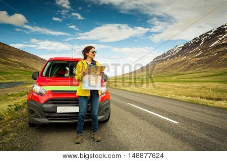 Female tourist watching a map and finding the right way